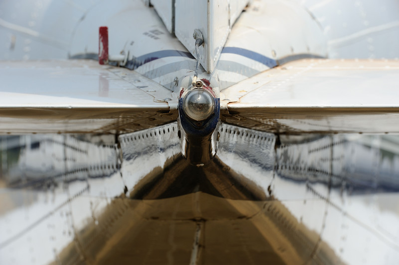 """the rear end of a Cessna 421 (registration 5X-VIP), Queen Elizabeth National Park, Uganda. Aircraft share the grass airstrip with everything from dragonflies to elephants.<br><span style=""""font-size:75%"""">exhibited at Sidney Sussex College, University of Cambridge, 2013</span><br><span style=""""font-size:75%"""">©Yangchen Lin</span>"""