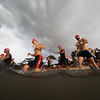 """Triathletes take to the high seas as the feeble rays of the morning sun are quelled by thunderheads rolling in from the west—a Rachmaninov Piano Concerto No. 3 played by Nature's philharmonic orchestra. Tri-Factor triathlon 2016, East Coast Park, Singapore.<br><span style=""""font-size:75%"""">©Yangchen Lin</span>"""