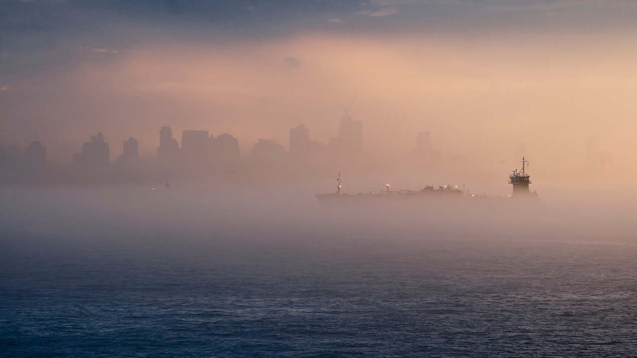 Foggy morning in New York Harbor.  Silhouette of Manhattan. <br /> All rights are reserved. High resolution photographs with no watermarks and no frames available upon request. Write your inquiries to anikonov@yahoo.com