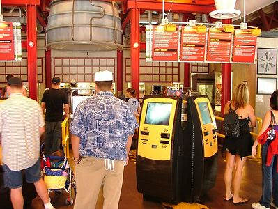 Cast Members were available to help guests use the new machines