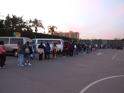 A long line to catch the bus to the park