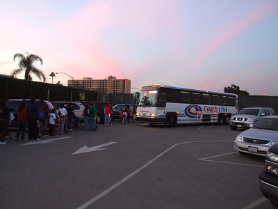They can't use trams, since the route uses city streets, so Disney hired Coach USA (operators of the ART system) to provide the buses