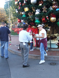 The PhotoPass employees on Main Street have returned to the traditional costume, instead of the brown vest.