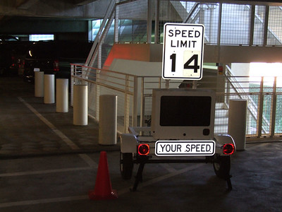 It is a radar gun that displays your speed, it is located on the North end (the lane that takes you to the exit).