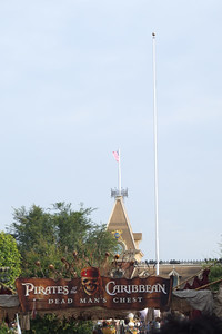 A group of Pirates storm the Flagpole area, and decide to raise the Pirates flag (The American Flag was already removed earlier in the day during the normal FLag Retreat.