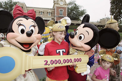 """DISNEY PARKS WELCOME TWO-BILLIONTH GUEST -- Emmalee Mason, 12, of Colorado Springs, Colorado, became the honorary two-billionth guest to ever visit a Disney Park just after 9:00am today at Disneyland in California. To commemorate this milestone, 50 years in the making, Emmalee was presented with a giant golden """"Key to the Kingdoms"""" and a lifetime pass to all 11 Disney Parks at the five Disney Resorts in Florida, Japan, France and Hong Kong, in addition to Disneyland Resort in Southern California.  © Disney Enterprises/Scott Brinegar"""