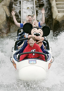 """DISNEY PARKS WELCOME TWO-BILLIONTH GUEST -- Emmalee Mason, 12, of Colorado Springs, Colorado, became the honorary two-billionth guest to ever visit a Disney Park just after 9:00am today at Disneyland in California.  To celebrate this milestone, Emmalee, along with Mickey Mouse, took her first-ever roller coaster ride on the world's first-ever tubular steel roller coaster, the Matterhorn.  Earlier she was presented with a giant golden """"Key to the Kingdoms"""" and a lifetime pass to all 11 Disney Parks at the five Disney Resorts in Florida, Japan, France and Hong Kong, in addition to Disneyland Resort in Southern California.  © Disney Enterprises/Scott Brinegar"""