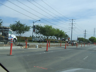On Disney Way, they are adding left turn lanes in the median to allow access to the Garden Walk parking lot