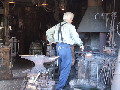 Hand crafted items are still available at Knott's, here is a Blacksmith working on a Miniature Horseshoe
