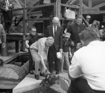 Mrs. Knott's christening the Log Ride with Boysenberry Juice with water as her Husband,John Wayne and his son John Ethan watches.