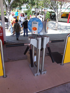 LEGOLAND has installed a new turnstyle system, there is no need for a MC (Model Citizen/employee). You just place in your ticket/AP and the turnstile unlocks for one click, and then locks back up, a light on top also turns green to allow the one person monitoring the area to know what is going on