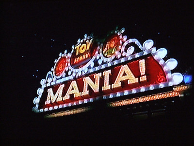"""Then they show an image of the attraction.  Note they edited the actual sign of the attraction to show just """"Toy Story Mania!"""" (removing the word Midway)."""