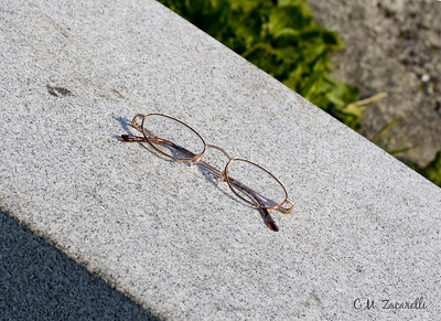glasses, maine, nubble light, york beach, long sands, stone bench, bench, lost, left behind
