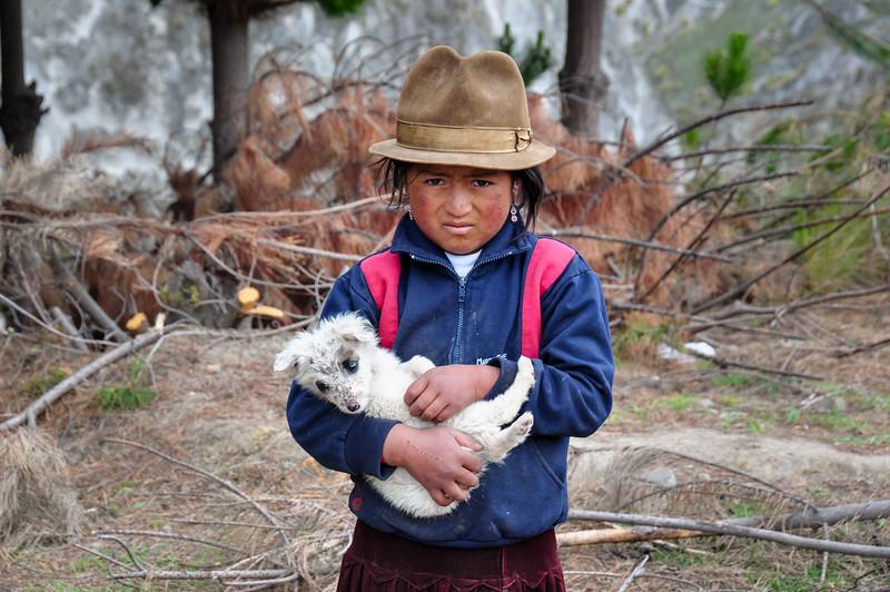 Young ecuadorian girl with dog near Quilotoa, Ecuador