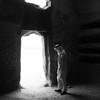 Saudian inside a Nabatean tomb in Madain Saleh archeological site, Saudi Arabia