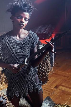 Black warrior woman holding a sword