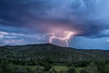 Lightning Strikes behind a hillside in the Mimbres Valley of New Mexico