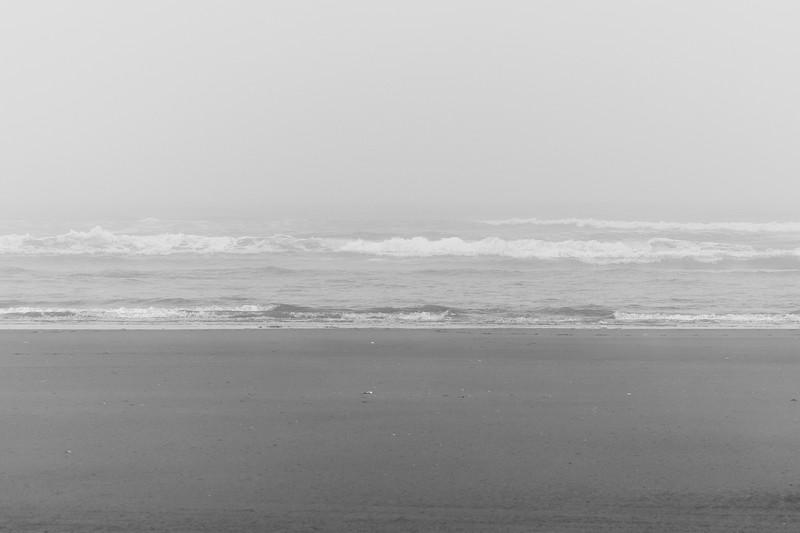 Grays Harbor, Seabrook - Waves crashing ashore on a foggy day