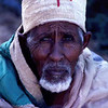 He sits under god, but still needs our help. That's the thought I had, photographing this poverty-stricken priest on the road. Ethiopia.