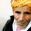 Watching the world go by, this kind old Berber posed for me outside the gates to the Medina, Fez, Morocco