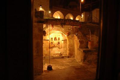 Interior courtyard at night, Cappadocia Cave Suites hotel, Goreme, Cappadocia, Turkey.