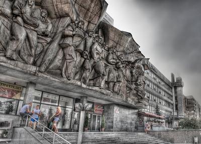Monument over a shop on 8th of March Square, corner of Mashrov Avenue and Nemiga Street, Minsk, Belarus.