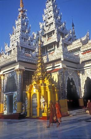 Monks at the Shwedagon pagoda, Rangoon, Burma.