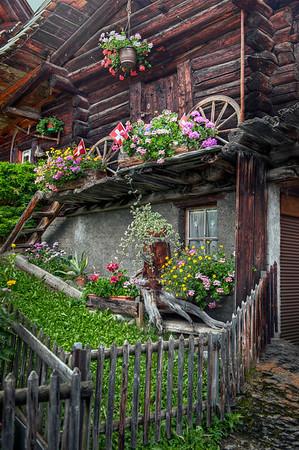 House and garden in the Alpine village of Mürren, Switzerland, HDR.