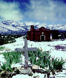 PenaBlanca, New Mexico - While enjoying a tour in my cousin's new BMW, I asked her to pull over and let me photograph this adobe church.  We were traveling on a rual road through the Sandia Mountains that connects Abuquerque and Las Alamos.  I returned to the car covered with snow and mud, but she still let me in and now displays this photo in her home.  Thank you, Laurie.