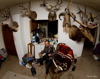 Carlsbad, NM hunter, Gary Darling, poses with his rifle and his tropies.