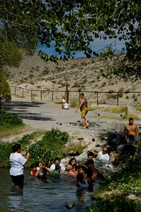 Ash Springs, Nevada, Mexican farmhands take a dip in a desert oasis.   The water was cool even though the air temperature was 110.