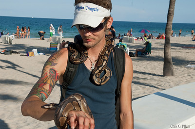Florida, Ft. Lauderdale Beach - This snake charmer also charms ladies at the beach.