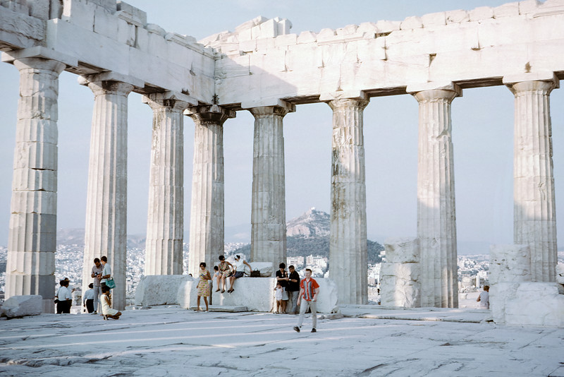 Me in my favorite red shirt striding across the Parthenon in Athens Greece.