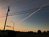"Morning ""Chemtrails."" After returning a library book this morning. I snapped this shot of a jet trail heading into the rising sun. Even exhaust can satisfy in the right light."