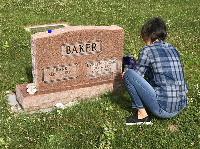 On our way home we stopped by the Livingston Cemetary to clean my mother's grave and leave some of her favorite ceramic flowers on the headstone. Mali used cheap vegetable oil to remove the stone stains. It worked like a charm.