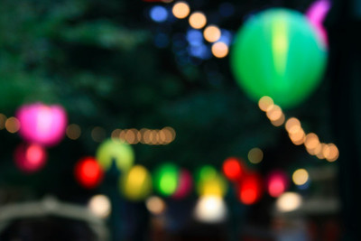 Lanterns at a festival bar. Apparently this photographic effect is called bokeh.