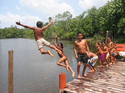 Children playing outside their house in the Brazilian Amazon. 2003