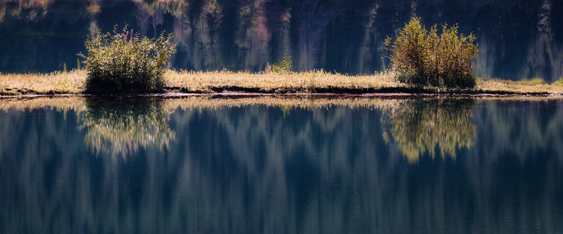 Snoqualmie Pass, Gold Creek Pond - Small island reflected in lake with shrubbery