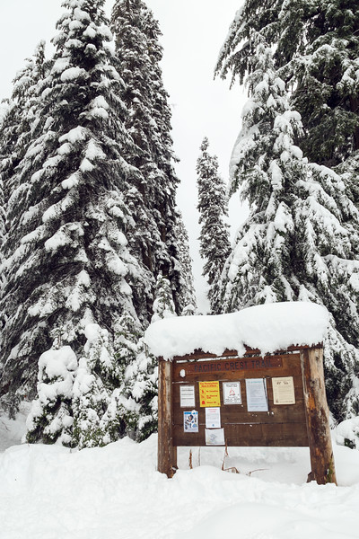 Snoqualmie Pass, PCT South - Trailhead sign in snow, vertical