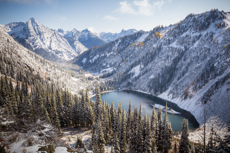 Rainy Pass. Maple Pass - Lake Ann in a snow-covered valley with fall colors