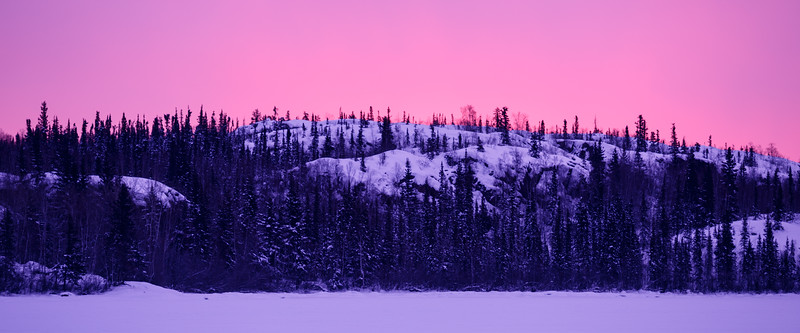 Yellowknife, Dettah Ice Road - Colorful sunrise over a snowcovered hill