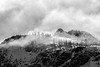 Rainy Pass. Maple Pass - Distant snowy ridge in fog and clouds, black and white