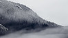 Whatcom, Skagit - Snow line on distant hill with fog and clouds