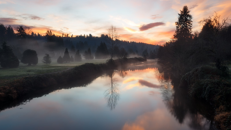 Bothell, Wayne - Colorful sunrise with fog over the river, horizontal