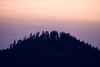 Kittitas, Peoh Point - Distant hill with silhouetted trees and colors of cloudless sunset