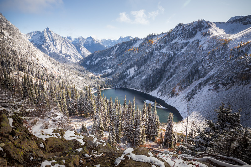 Rainy Pass. Maple Pass - Lake Ann in a snow-covered valley with fall colors, wider