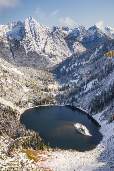 Rainy Pass. Maple Pass - Lake Ann in snow-covered valley with snow and fall colors, vertical