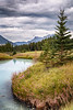Canmore, Stinky Pond - Wastewater pond in brilliant blue on a cloudy day