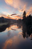 Bothell, Wayne - Colorful sunrise with fog over the river, vertical