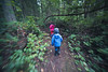 Skagit, Kukutali Preserve - Motion following two little kids through the forest